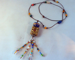glass and African beads on leather