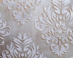 Metallic silver and brass with ornamental stencil on canvas