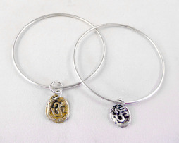 Sterling bangle with hand-fired brass or sterling om charm