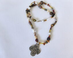 Beaded necklace with a silver pendant