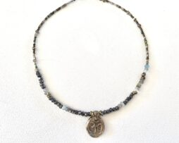 Blue beaded necklace with a small charm
